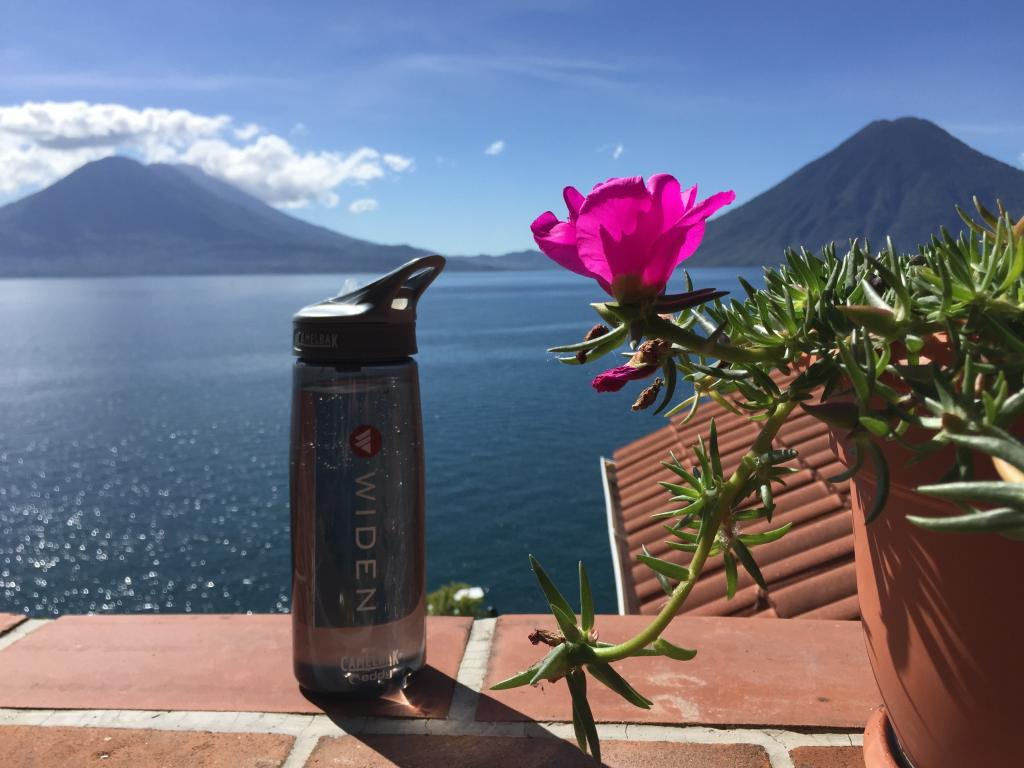 Widen water bottle shot overlooking Lake Atitlán in Guatemala