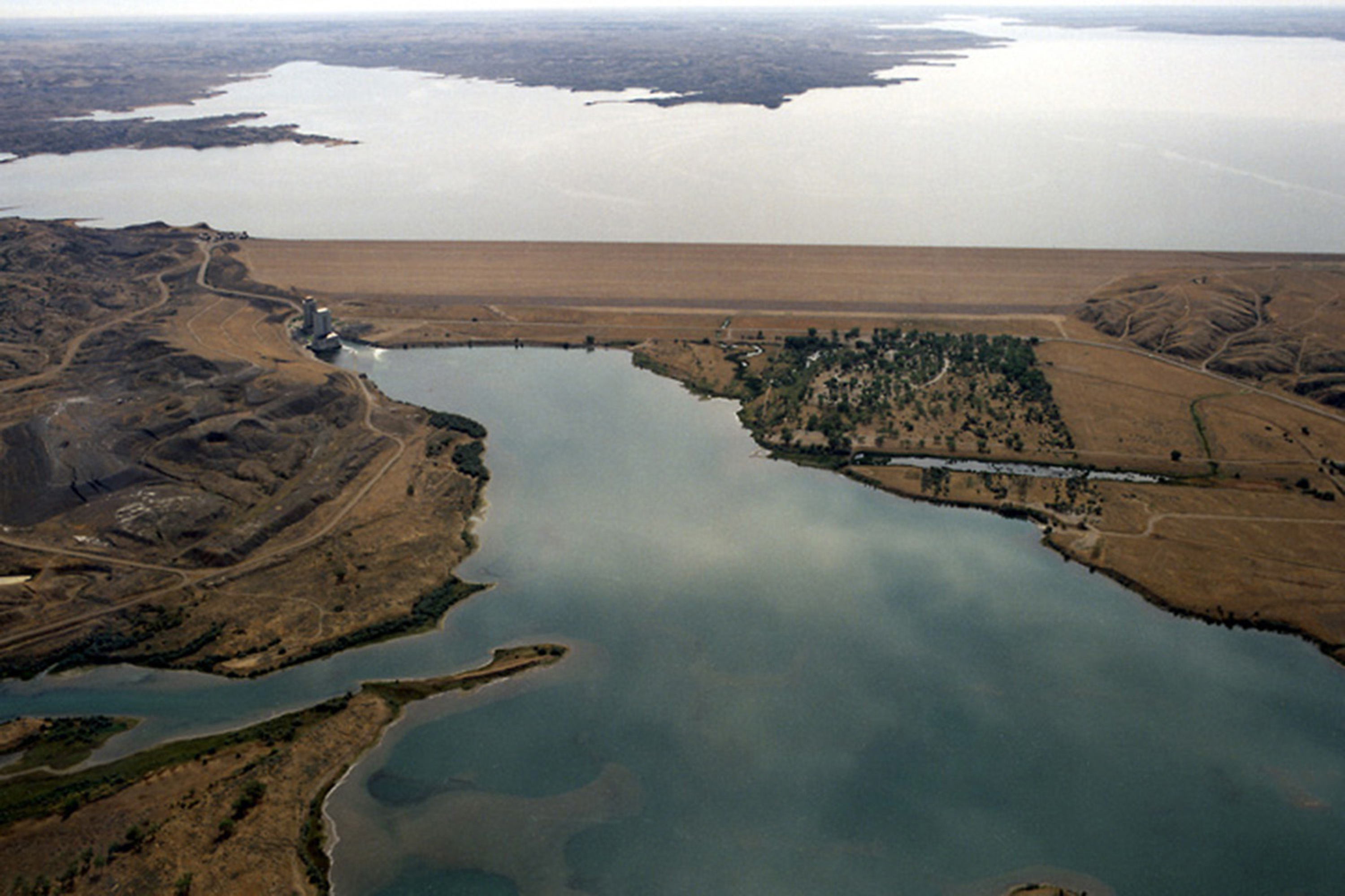 Image of Fort Peck Dam with arial views of the lake and land around the dam.