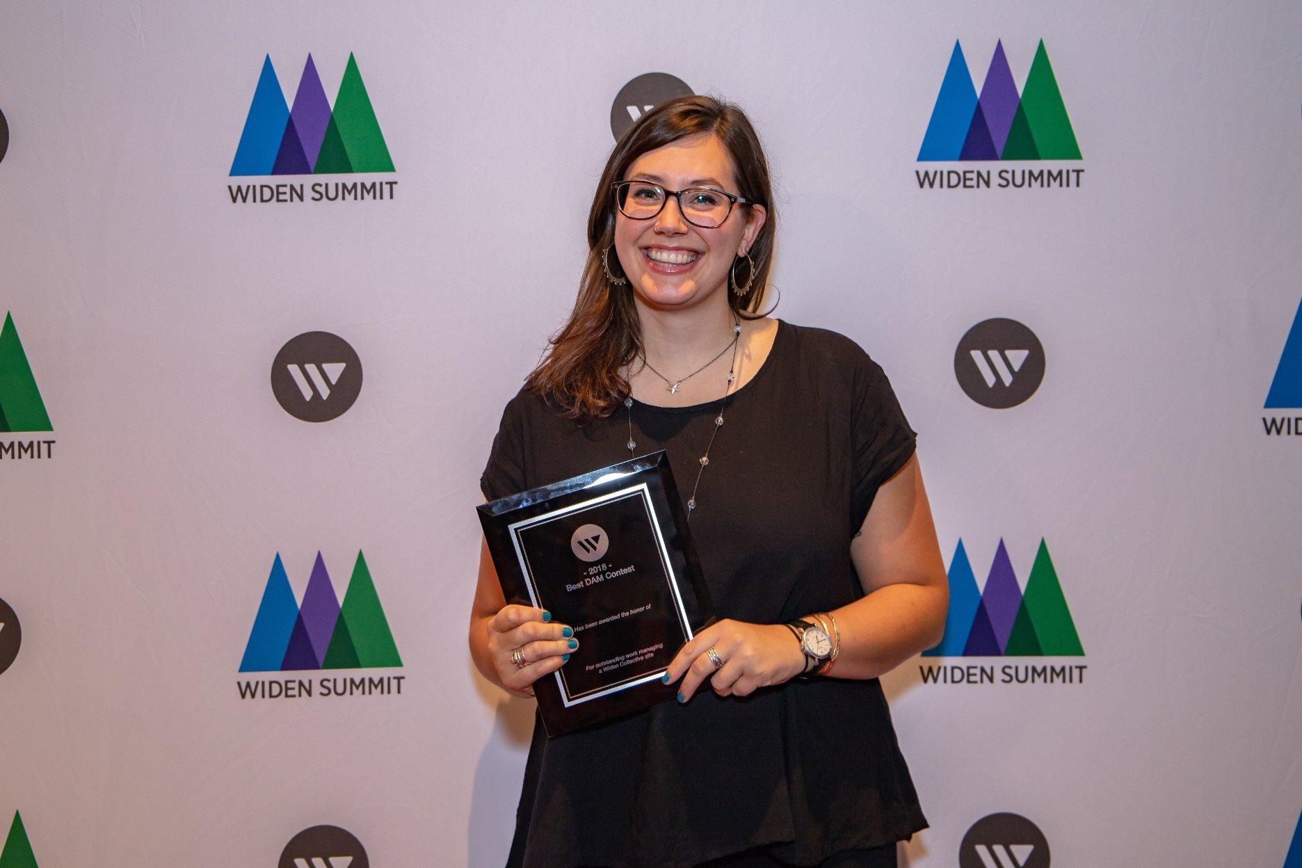 Caroline proudly holding her Best DAM award